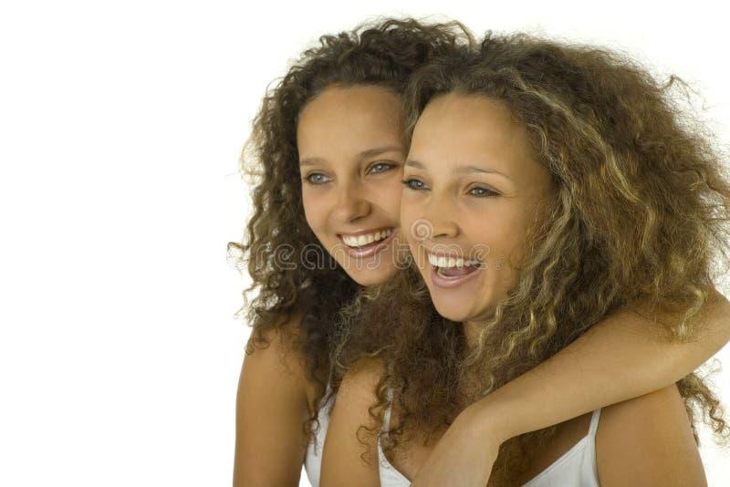 Gemelos en abrazo foto de archivo libre de regalías