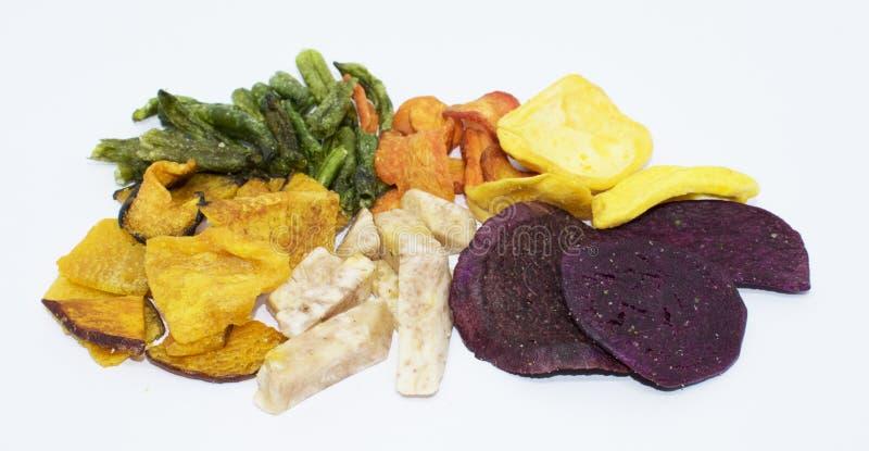 Gemengde droge vruchten groentespaanders op achtergrond royalty-vrije stock fotografie