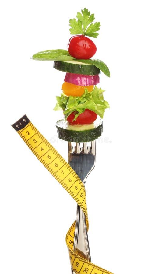 Gemengde groenten op een geïsoleerde vork. stock fotografie