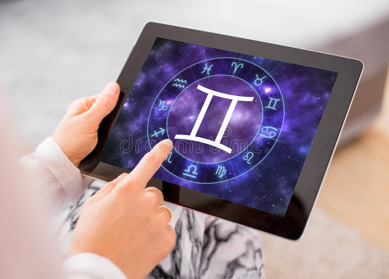 Gemini zodiac sign. On tablet royalty free stock photos