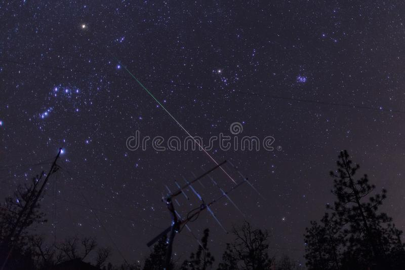 Geminid meteor over ham radio satellite antenna. Oregon, Ashland, Cascade Siskiyou National Monument, Taken 12.2017 stock photos