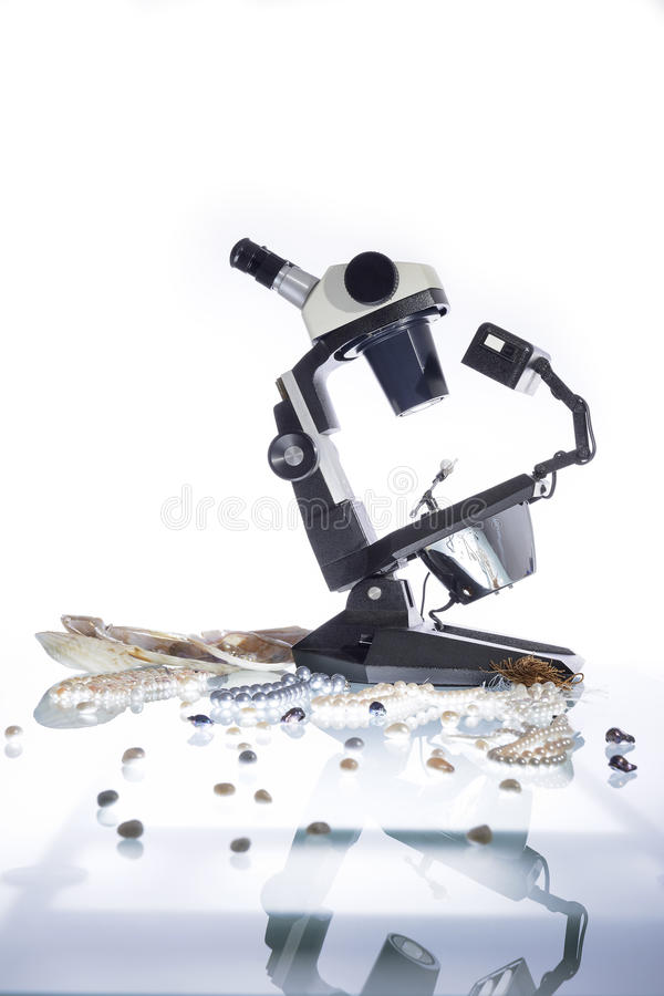Gemologist and microscope royalty free stock photo
