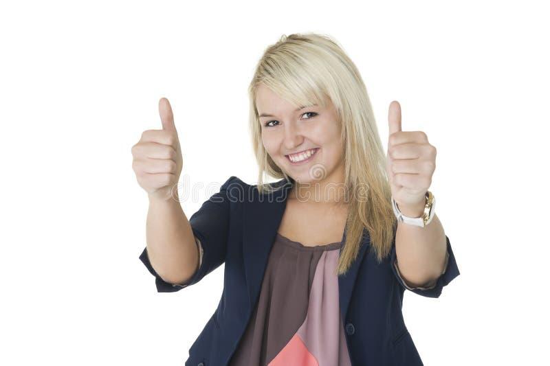 Gemotiveerde vrouw die dubbele duimen opgeeft stock afbeeldingen