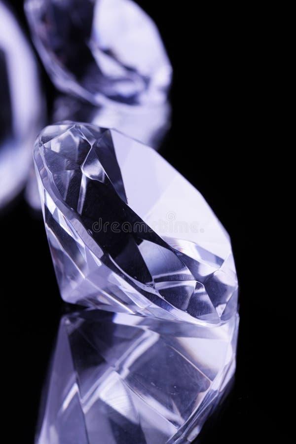 Gemstones on black mirror royalty free stock images