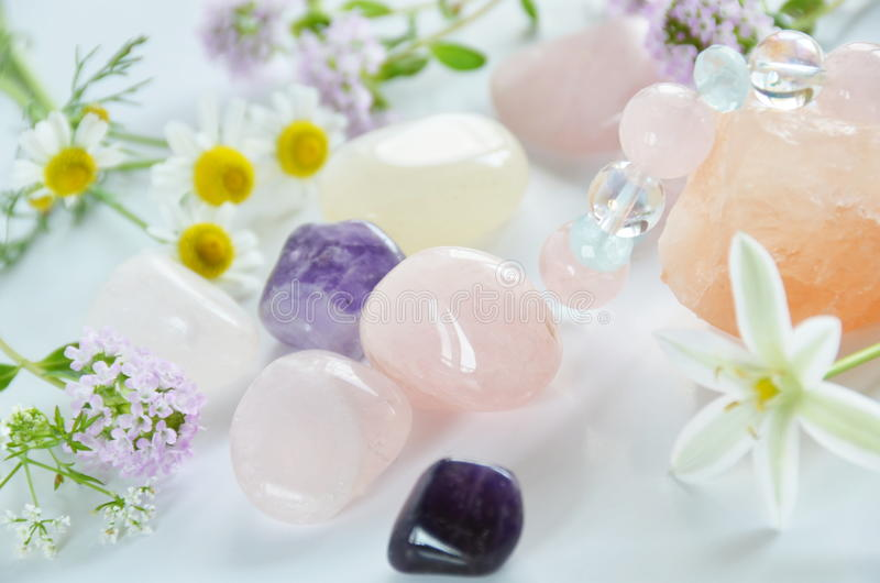Gemstones with flowers royalty free stock image
