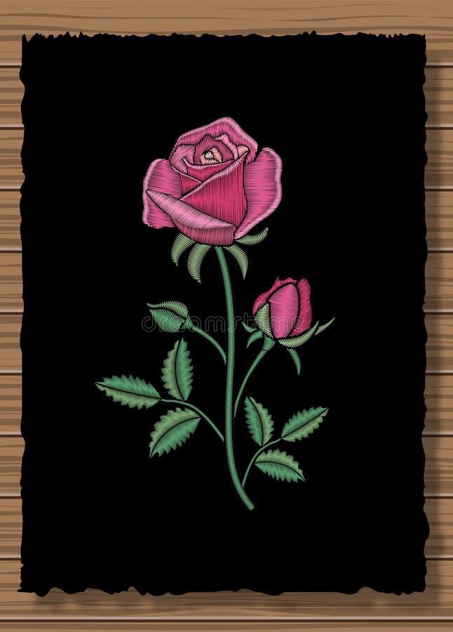 Genähte Blumenverzierung mit Stich stieg Stickereiblume auf einem dunklen Klappenstoff und hölzernen einem Beschaffenheitshinterg lizenzfreie abbildung
