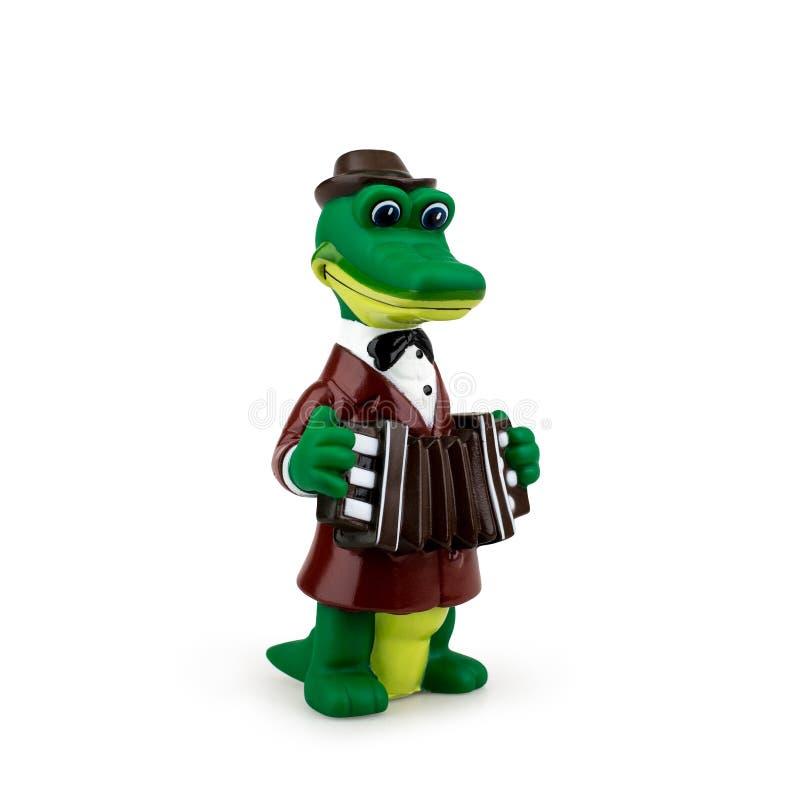 Gena do brinquedo das crianças o crocodilo no fundo branco imagem de stock