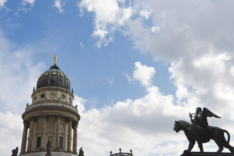 Gendarmenmarkt, Berlin, Dome of French Cathedral and Monument with Angel royalty free stock photography