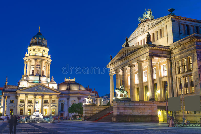 The Gendarmenmarkt at night. The Gendarmenmarkt in Berlin illuminated at night stock photos