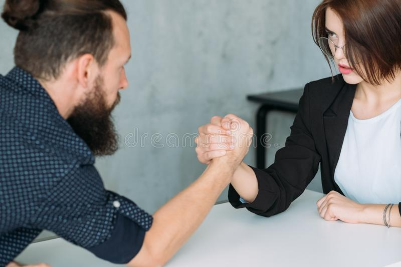 Gender equality leadership man woman armwrestling. Gender equality. Leadership and competition. Man and women armwrestling royalty free stock images