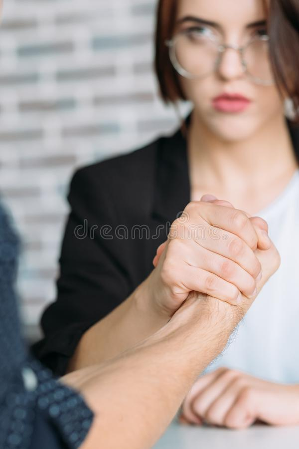Gender equality leadership man woman armwrestling. Gender equality. Leadership and competition. Man and women armwrestling stock images