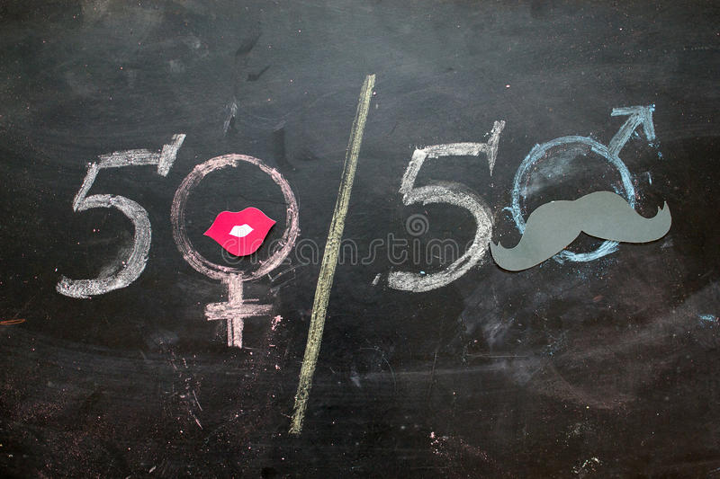 Gender symbols or signs for the male and female sex drawn on a blackboard royalty free stock photography