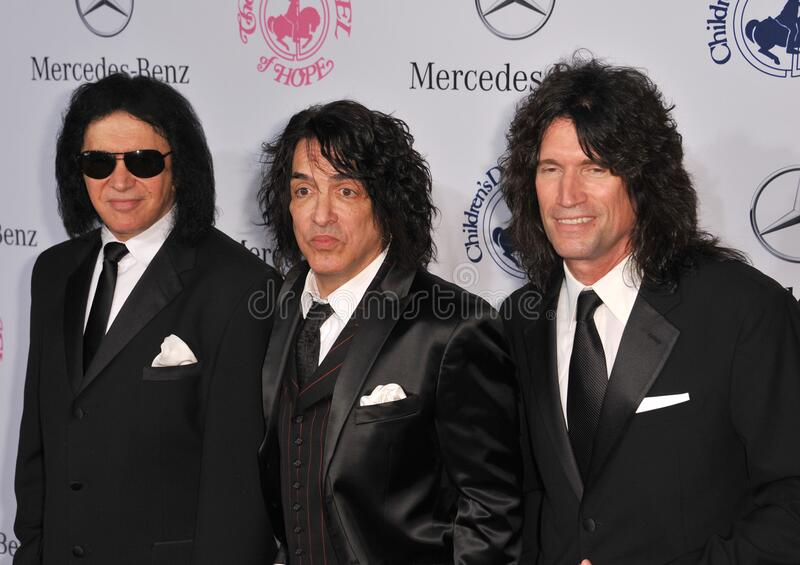 Gene Simmons & Paul Stanley & Tommy Thayer. LOS ANGELES, CA - October 20, 2012: KISS stars Gene Simmons (left), Paul Stanley & Tommy Thayer at the 26th Carousel royalty free stock photography