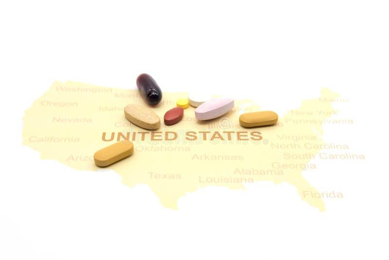Geneeskunde op een Amerikaanse kaart Het concept van de gezondheidszorg stock foto