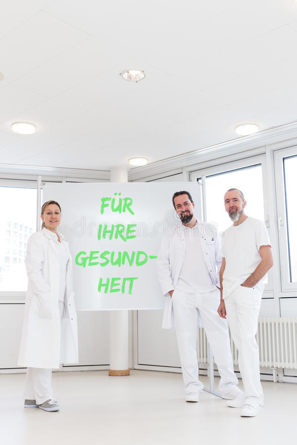 Geneeskundearbeiders voor witte raad stock afbeeldingen