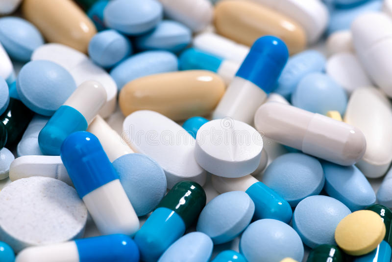 Geneeskundepillen stock foto