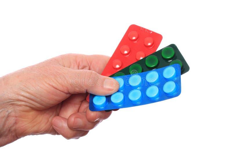 Geneesmiddelen in de hand van het bejaarde royalty-vrije stock afbeelding