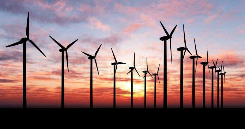 Generadores de viento sobre el cielo anaranjado imágenes de archivo libres de regalías