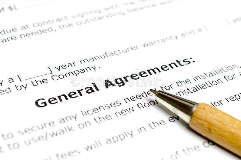 General Agreements with wooden pen. Close up royalty free stock images