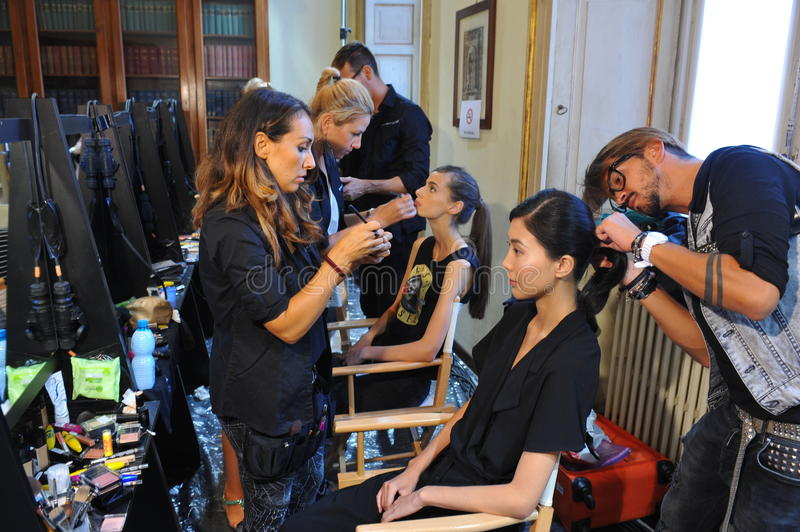 A general atmosphere backstage during the Chicca Lualdi show as a part of Milan Fashion Week. MILAN, ITALY - SEPTEMBER 17: A general atmosphere backstage during stock photos