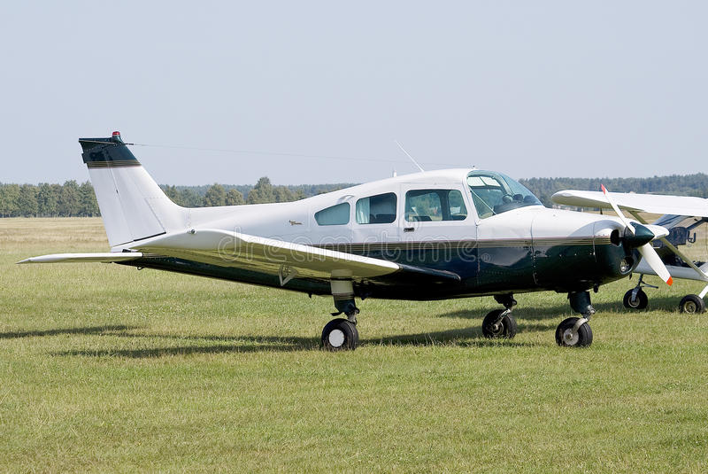 General aviation. Small general aviation airplane standing on the grass apron royalty free stock photo