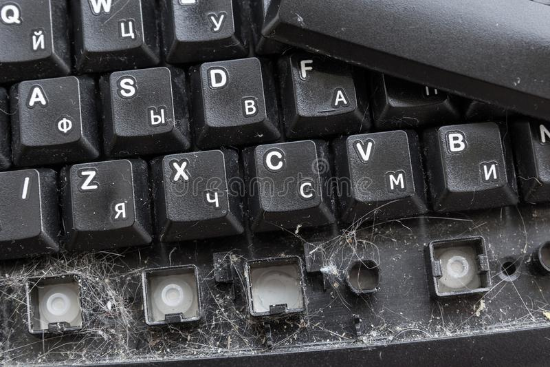Keyboard disgusting dirty. General cleaning of the keyboard. Cat hair and dirt under the keyboard keys stock images