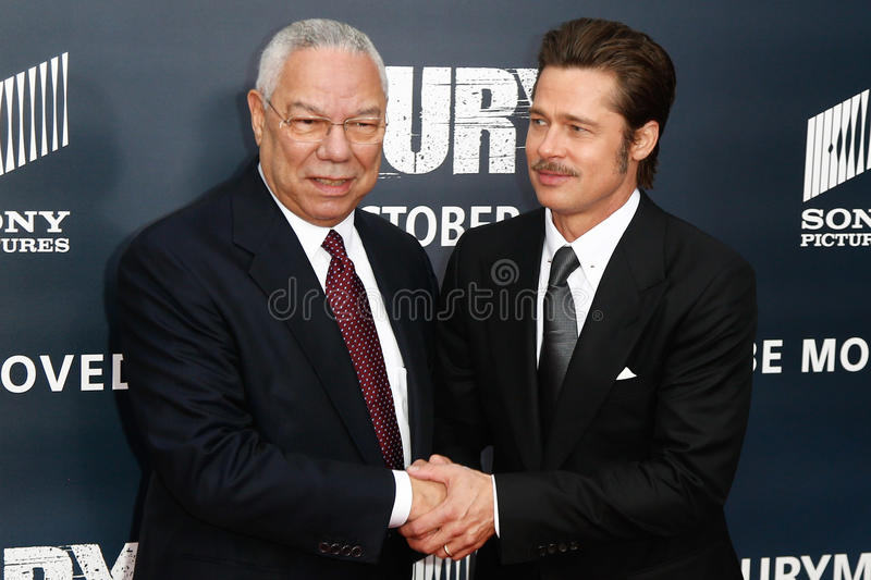 General Colin Powell, Brad Pitt. NEW YORK-OCT 15: General Colin Powell (L) shakes hands with actor Brad Pitt at the world premiere of The Fury at the Newseum on royalty free stock images