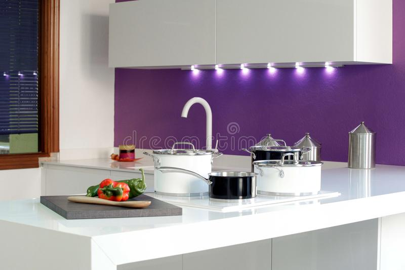General plan of a kitchen with black and white pots. stock photography