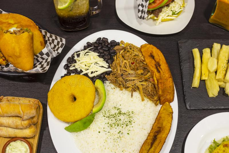 General plan of varied dishes of Venezuelan cuisine. Traditional, ingredient, sauce, flour, breakfast, latin, homemade, lunch, black, beans, grilled, snack royalty free stock photography