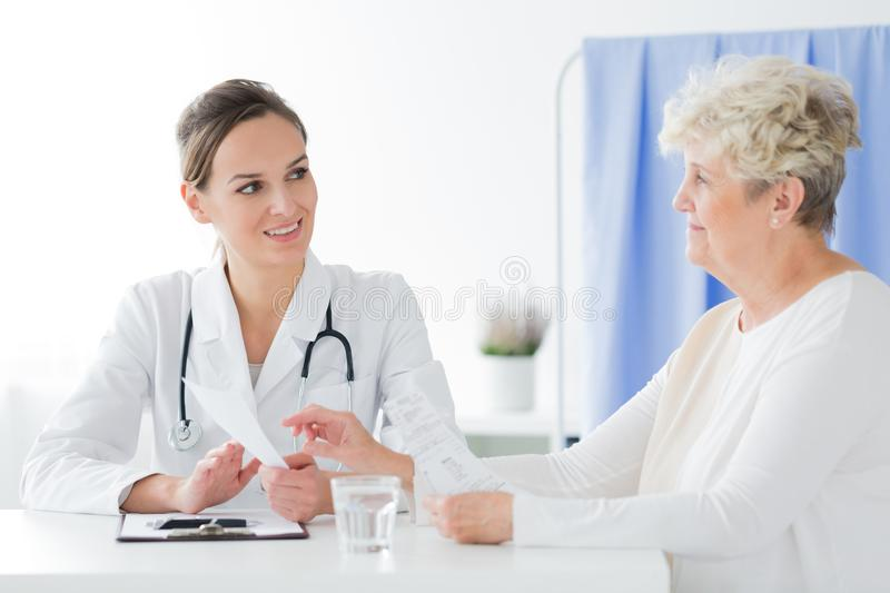 General practitioner doing medical interview royalty free stock photography