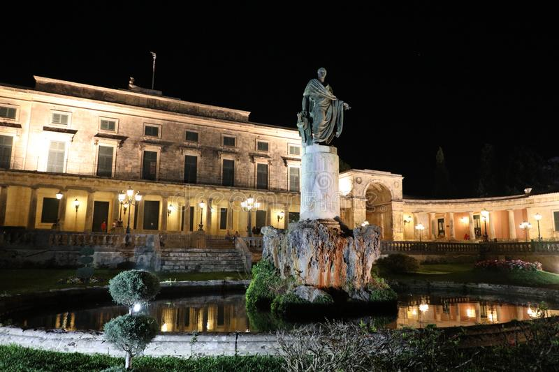 Statue of Sir Frederick Adam by Pavlos Prosalentis in front of Palace of Saint Michael and George by night, Kerkyra, Corfu Island, royalty free stock images