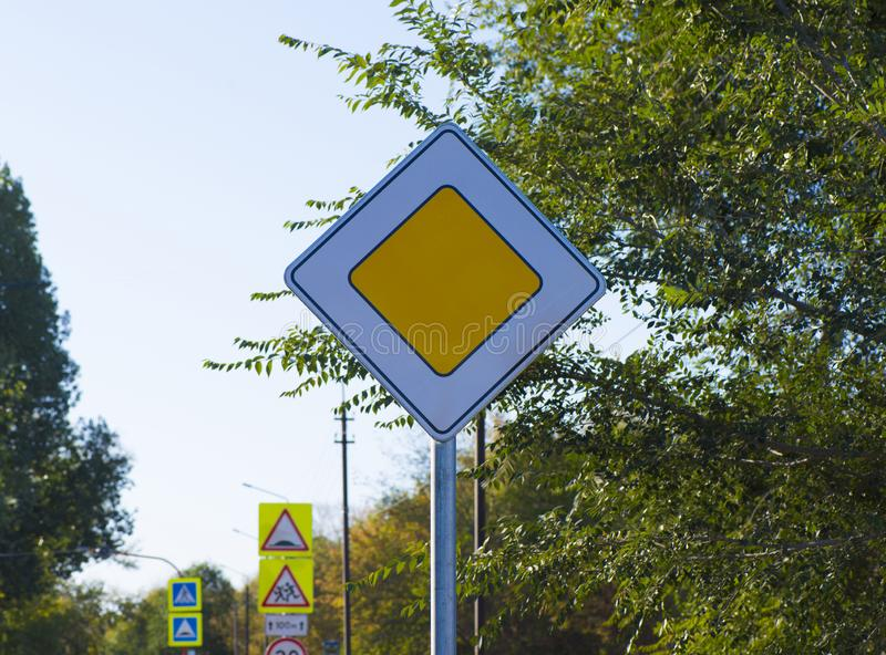 General traffic signs. Road sign main road on the roadway of the street royalty free stock image