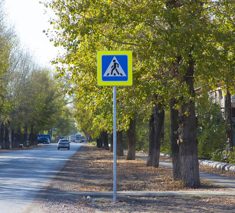 General traffic signs. Road sign pedestrian crossing on the roadway royalty free stock photo