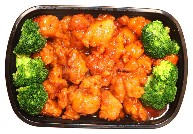 General TSO Chicken and Brocolli To Go. To go or delivery container of general tso chicken and broccoli. Top view over white stock photography