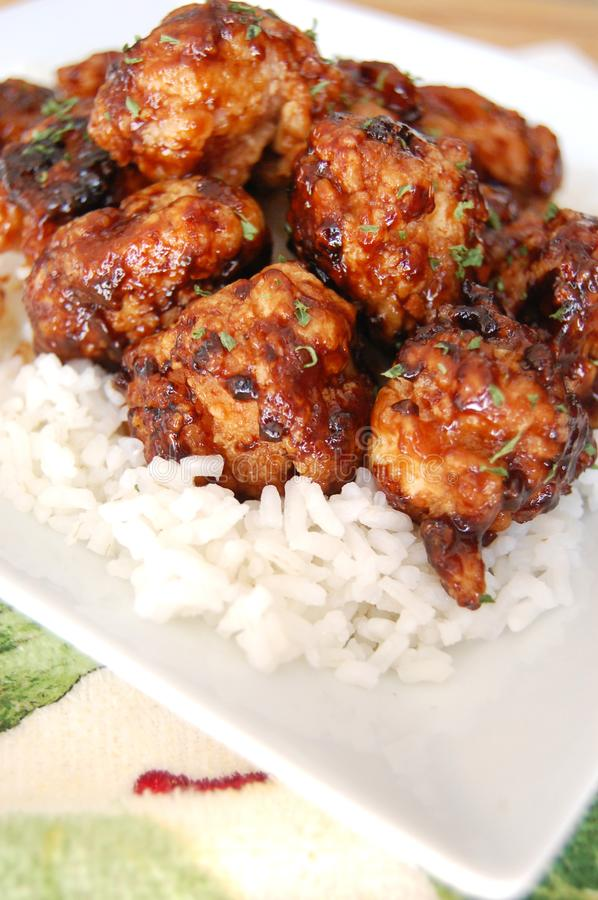 General Tso Chicken Dinner. General Tso Chicken on top of white rice plate royalty free stock photos