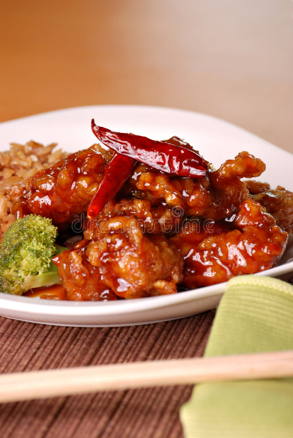 General tso's chicken. With spicy chili peppers royalty free stock images