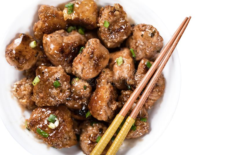 General Tso`s Chicken. Asian chicken, chopped breast fillets with sweet sauce, top view. horizontal view from above stock photography