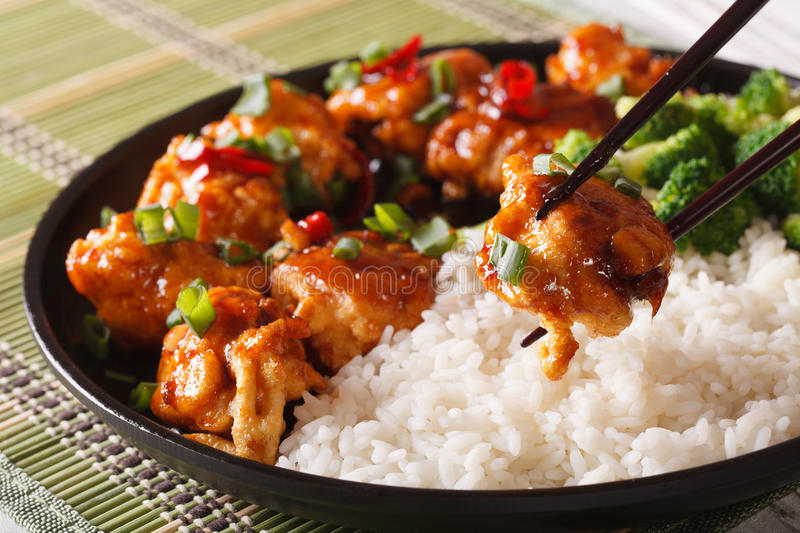 General Tso's chicken with rice for dinner. Horizontal close-up. Asian food: General Tso's chicken with rice for dinner. Horizontal close-up royalty free stock photo