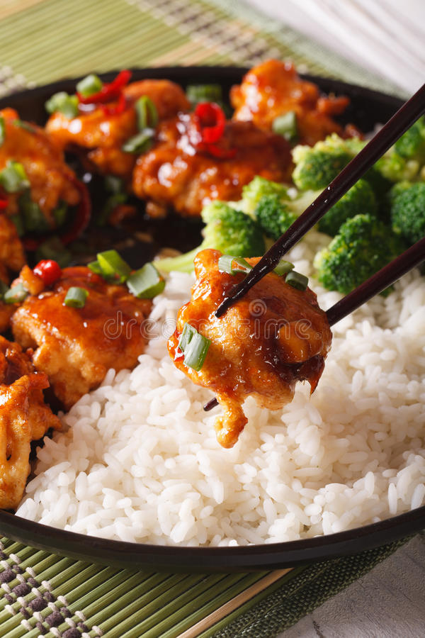 General Tso's chicken with rice for dinner. vertical, macro royalty free stock photos