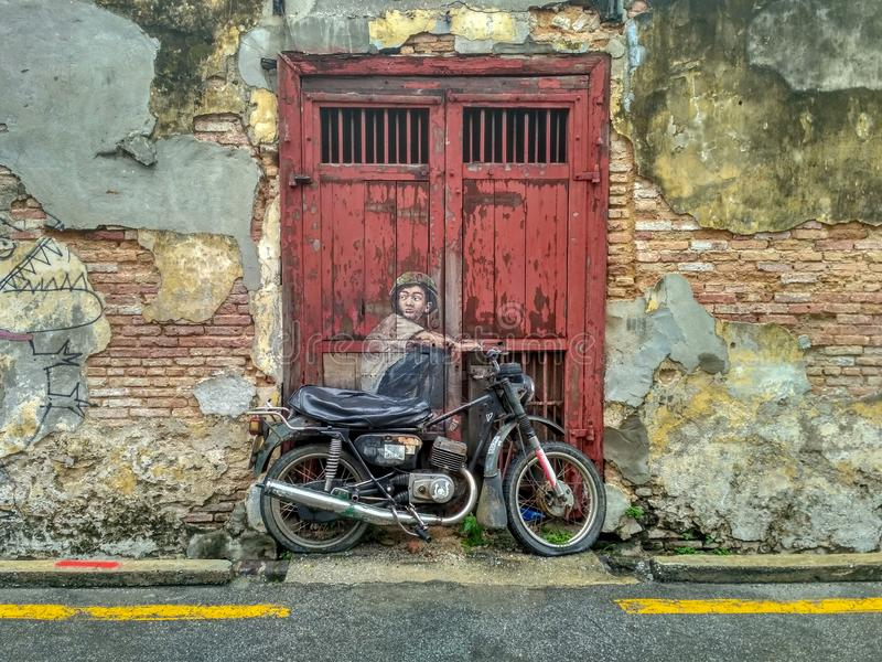 General view of a mural `Boy on a Bike` stock images
