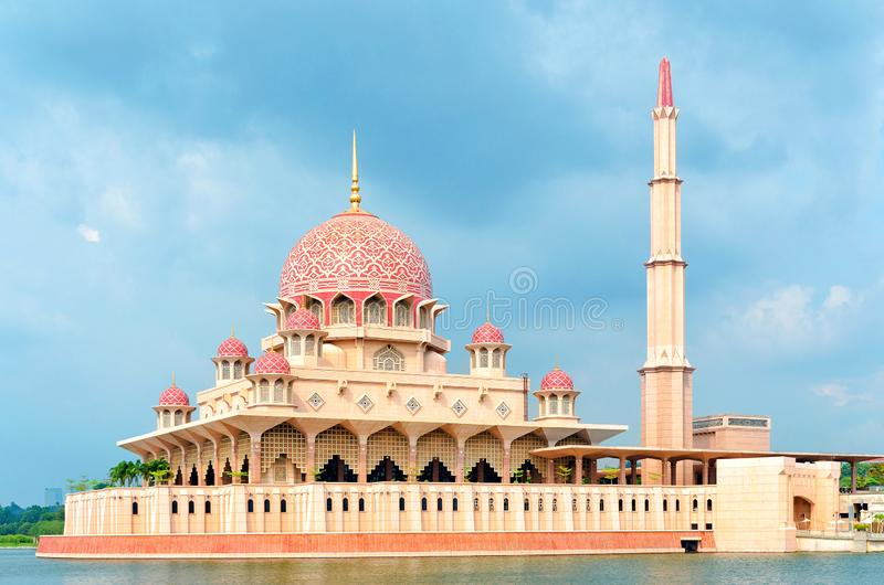 General view of the Putra Mosque with Putrajaya Lake, dramatic sky royalty free stock images