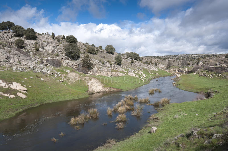 General view of the river Manzanares. Where it passes Colmenar Viejo, Madrid Province, Spain. This river has had a great historical importance due to its close royalty free stock photos