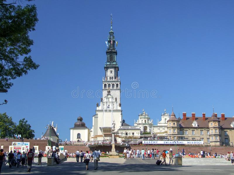 General view on square at Jasna Gora Monastery in Czestochowa in Poland. Pilgrims visiting the Jasna Gora. Many people seen from behind or walking. Couple in the stock photo