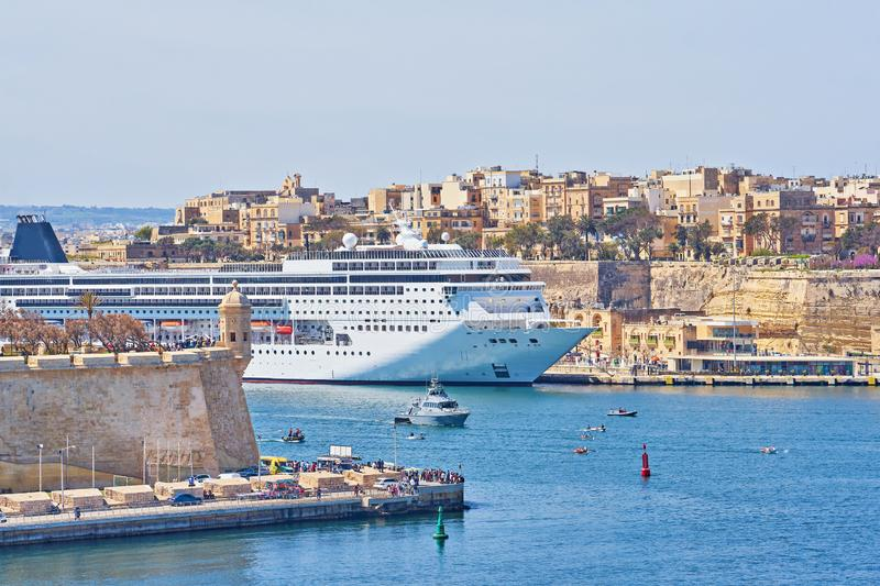 General view of Valletta Grand harbor in Malta with large cruise liner ship in sea bay. General view of Valletta Grand harbor in Malta with large cruise liner royalty free stock photos