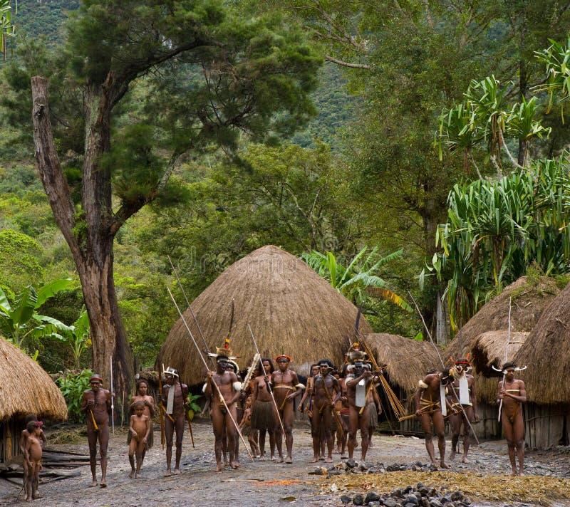 General view of the village of Dani tribe. DANI VILLAGE, WAMENA, IRIAN JAYA, NEW GUINEA, INDONESIA – 25 JULY 2009: General view of the village of Dani royalty free stock photography