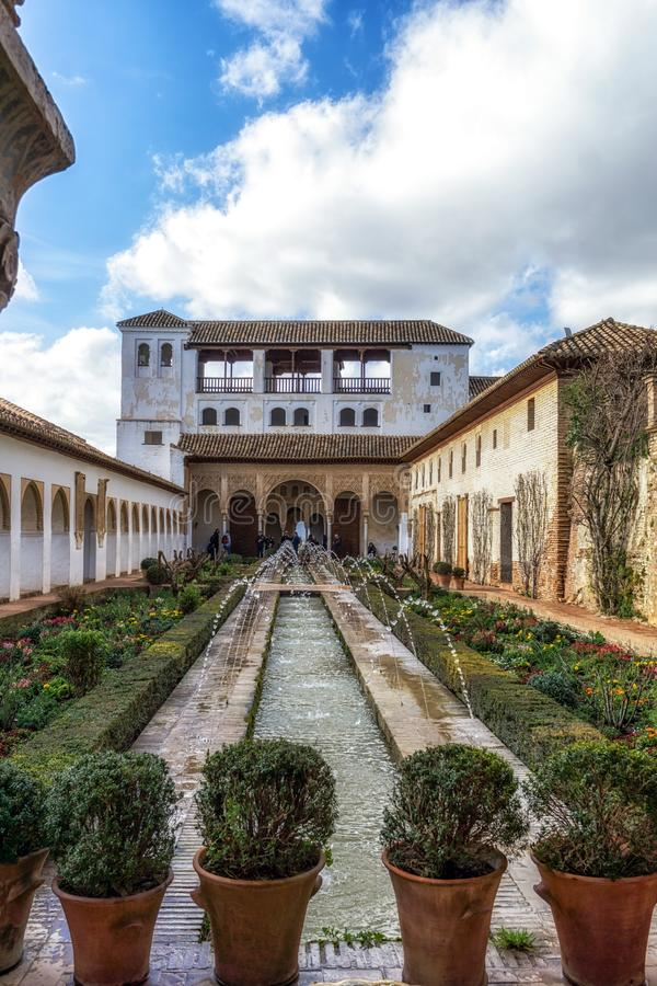 Generalife palace pool. With flowers by side in Alhambra Palace, Spain royalty free stock photography