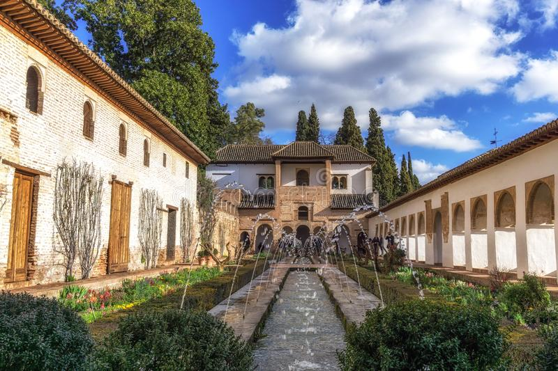 Generalife palace pool. With flowers by side in Alhambra Palace, Spain royalty free stock images