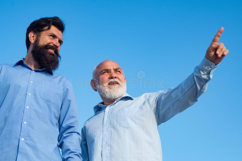 Generation of people and stages of growing up. Grandpa retiree. Portrait of two bearded men. Retirement parent. Generation of people and stages of growing up royalty free stock photos