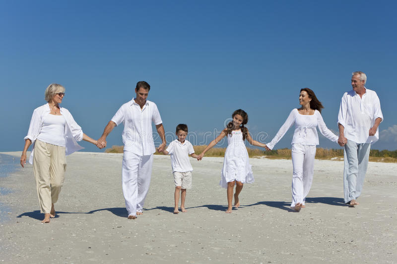 Generations Of Family Holding Hands On Beach Royalty Free Stock Image