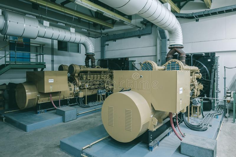 Generator. Room with two s in factory standby for power backup, Diesel stock photo